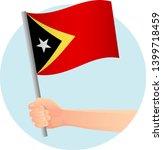 east timor flag in hand.... | Shutterstock .eps vector #1399718459