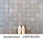 high heels on pavement... | Shutterstock . vector #1399782590