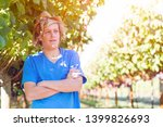 guy standing with arms folded... | Shutterstock . vector #1399826693