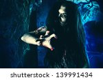 bloodthirsty zombi standing at... | Shutterstock . vector #139991434