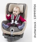 Small photo of booster seat with child for a car in light background. studio shot.