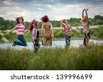 girls jump on the meadow ... | Shutterstock . vector #139996699