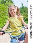 little girl on bike | Shutterstock . vector #139998544