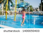 little girl playing in a... | Shutterstock . vector #1400050403