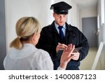 Small photo of Policeman makes witness interview after burglary and talks with witnesses