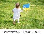 child carries fluttering blue... | Shutterstock . vector #1400102573