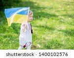 child carries fluttering blue... | Shutterstock . vector #1400102576