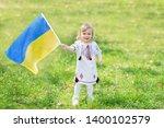 child carries fluttering blue... | Shutterstock . vector #1400102579