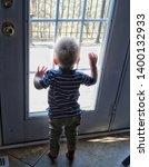 toddler boy looking out door...   Shutterstock . vector #1400132933