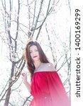 beautiful young woman wearing... | Shutterstock . vector #1400169299