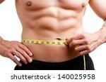 fit man measuring his waist... | Shutterstock . vector #140025958