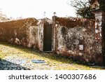an antique flaked mossy stony... | Shutterstock . vector #1400307686