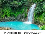 Waterfall With Turquoise Water...