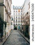 narrow cobblestone street in... | Shutterstock . vector #1400476100