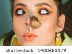 Stock photo massage with snail skincare repairing healing mucus having fun with adorable snail cosmetics 1400683379