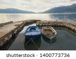 two old fishing boats in a... | Shutterstock . vector #1400773736
