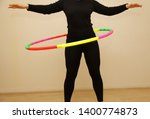 female is hula hooping. home... | Shutterstock . vector #1400774873
