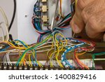 electrician working at... | Shutterstock . vector #1400829416