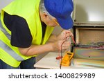 electrician working at... | Shutterstock . vector #1400829989