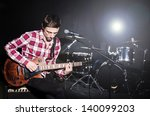 man playing guitar during... | Shutterstock . vector #140099203