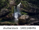 Scenic nature of beautiful waterfall and emerald pool of fresh water lake. Drinking water. Slap Virje, Virje waterfall, Bovec, Slovenia, Julian Alps, flowing water  - stock photo