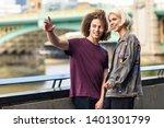 happy couple talking sitting... | Shutterstock . vector #1401301799