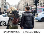 rear view of happy couple of... | Shutterstock . vector #1401301829