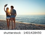 couples during sunrise at the... | Shutterstock . vector #1401428450