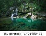 Virje Waterfall - beautiful waterfall located near Bovec town. Soca Valley, Triglav National Park, Julian Alps, Slovenia, Europe. - stock photo
