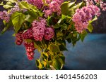 a bouquet of lilacs in a glass... | Shutterstock . vector #1401456203