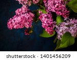 bouquet of lilac on a dark... | Shutterstock . vector #1401456209