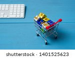 gift box on shopping cart ... | Shutterstock . vector #1401525623