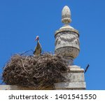 stork nesting in the spires of... | Shutterstock . vector #1401541550