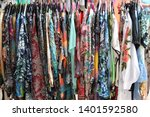 clothing at the cisne flea... | Shutterstock . vector #1401592580