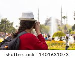 tourist woman in white hat with ... | Shutterstock . vector #1401631073