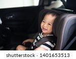 Small photo of Transport, safety, childhood road trip and people concept - Happy baby boy sitting in baby car seat or booster seat, Child in auto baby seat in car, Asian boy in summer vacation to travel with family.
