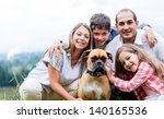 happy family with a dog... | Shutterstock . vector #140165536