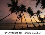 silhouette of palm trees at... | Shutterstock . vector #140166160