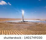 Solar power tower and mirrors that focus the sun's rays upon a collector tower to produce renewable, pollution-free energy, Aerial Image. - stock photo
