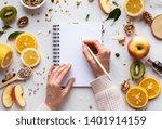 Female Hand Write In Notebook...