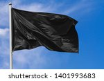 black flag waving in the wind... | Shutterstock . vector #1401993683