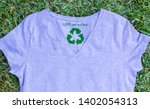t shirt on grass with recycled... | Shutterstock . vector #1402054313