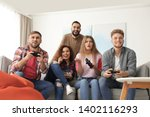 emotional friends playing video ... | Shutterstock . vector #1402116293