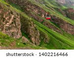ropeway in caucasus mountains.... | Shutterstock . vector #1402216466
