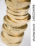A Pile Of Pound Coins On A...