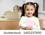 pretty  happy schoolgirl with... | Shutterstock . vector #1402257830