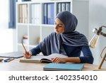 Female Muslim Professor Taking...