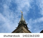 spire of the medieval abbey of... | Shutterstock . vector #1402363100