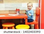 cute little caucasian blond... | Shutterstock . vector #1402403393