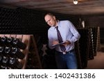 confident male winemaker... | Shutterstock . vector #1402431386